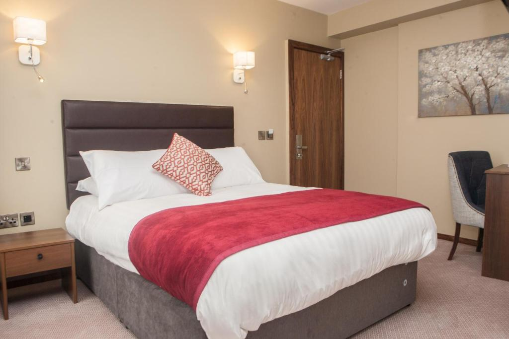 A bed or beds in a room at The Draper Rooms
