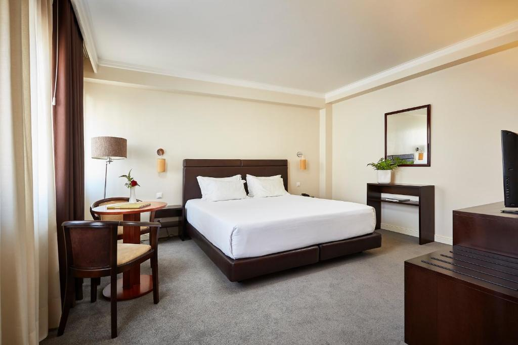 A bed or beds in a room at Hotel As Americas