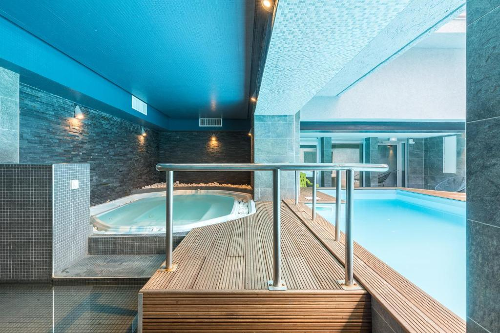 The swimming pool at or near Hotel & Spa Brise de Mer