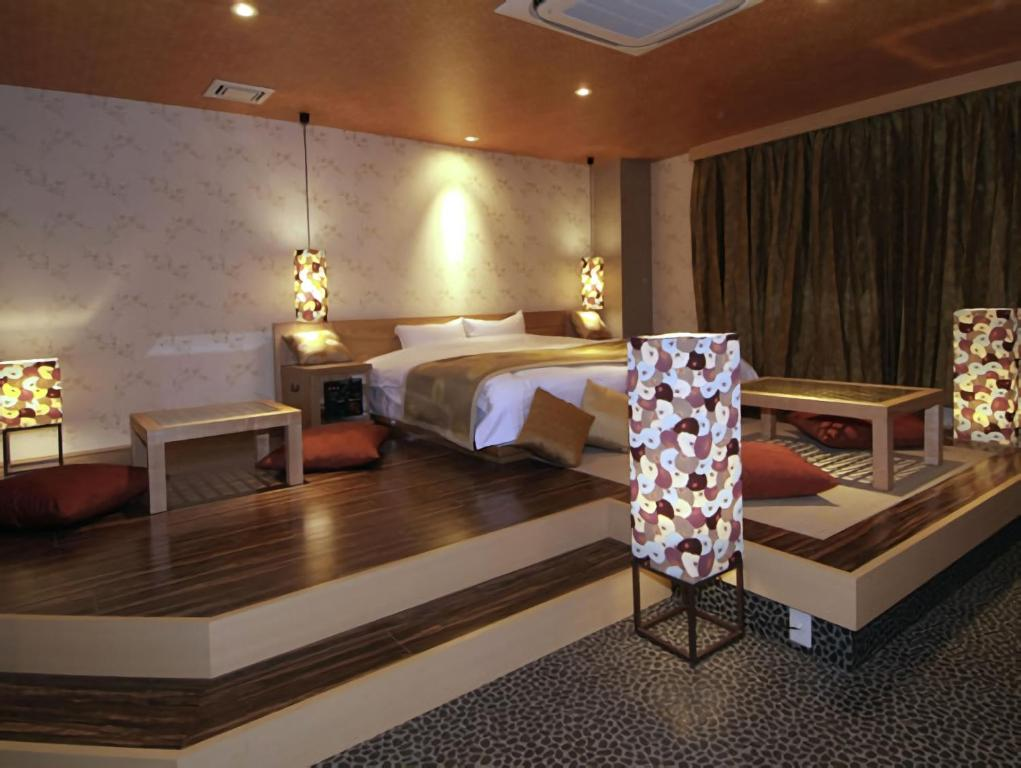 A bed or beds in a room at Hotel Cuna Kyoto (Adult Only)