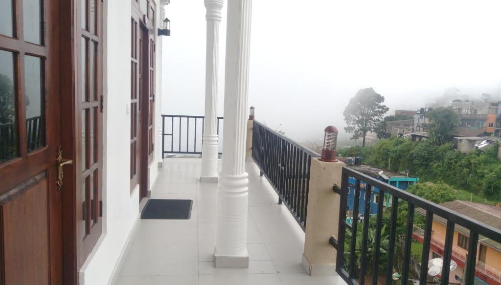 A balcony or terrace at Grand View Guest House