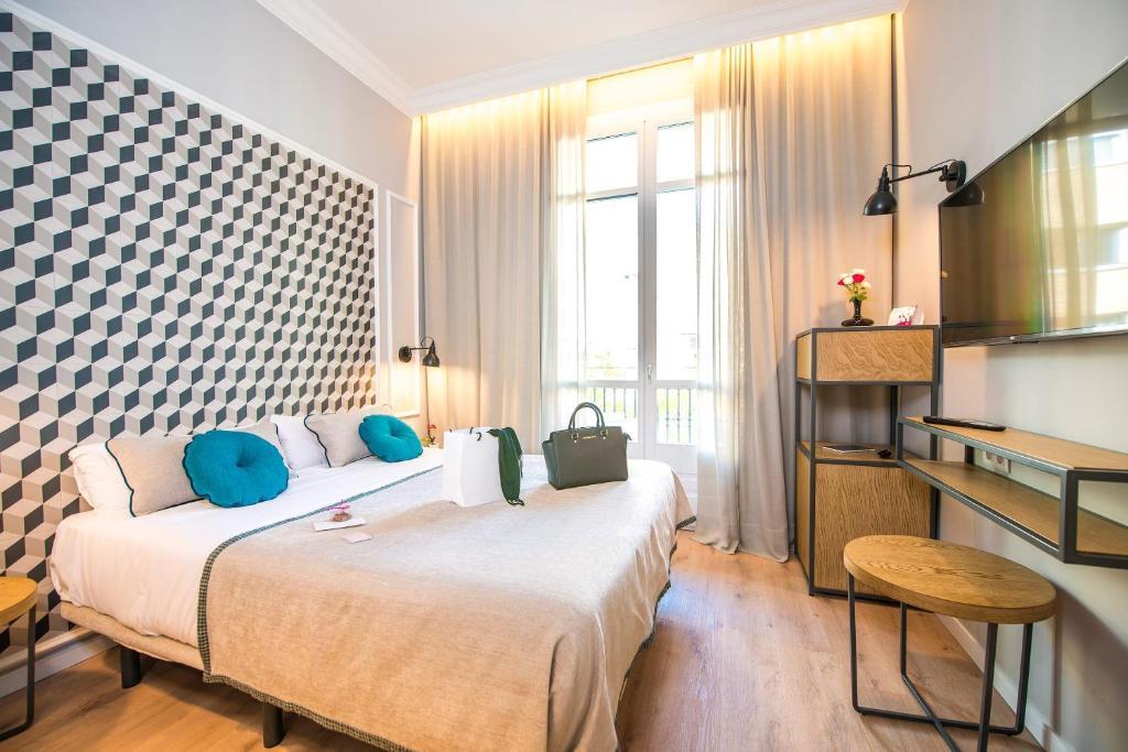 Un ou plusieurs lits dans un hébergement de l'établissement Ona Hotels Mosaic