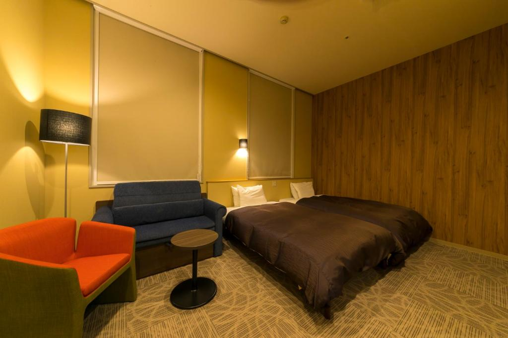 A bed or beds in a room at Riverside Hotel Kumamoto