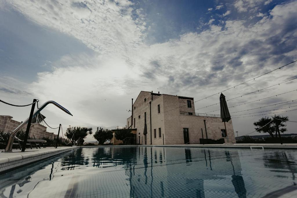The swimming pool at or close to Masseria Sacramento
