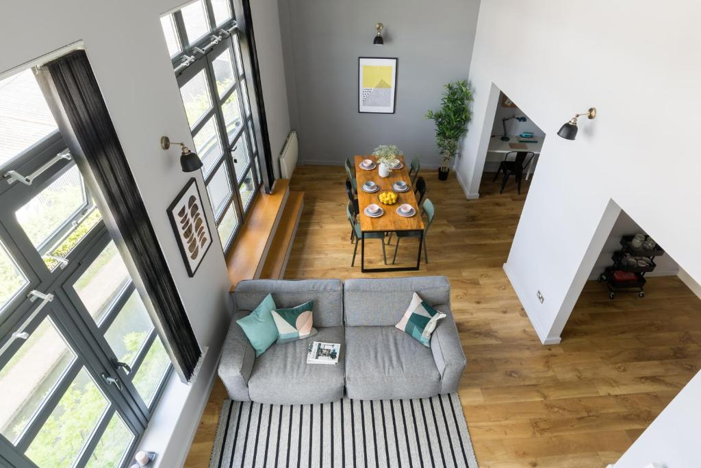 A seating area at 4B Loft Penthouse Industrial decor with canal & city views