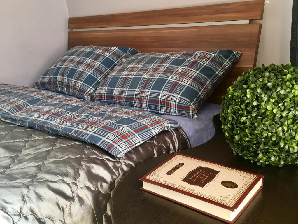 A bed or beds in a room at Lenskaya apartment