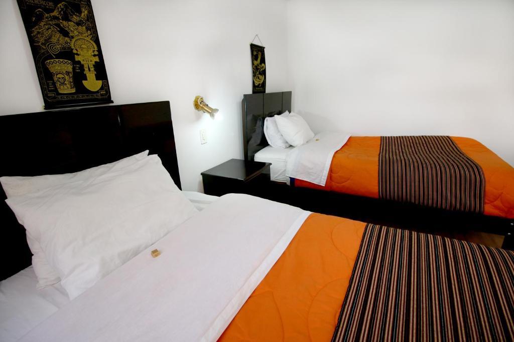 Cama o camas de una habitación en Hotel Peru Real