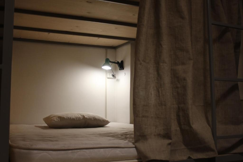 A bed or beds in a room at Sleep Studio Hostel