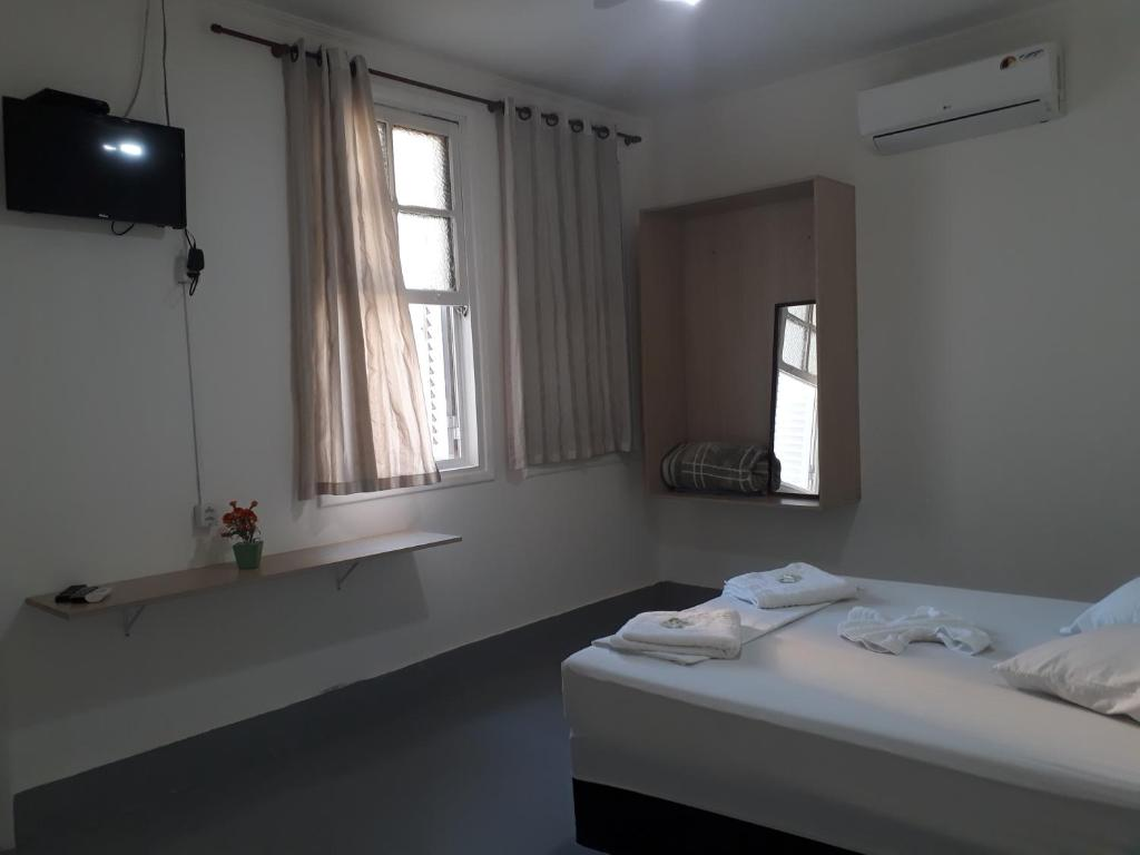 A bed or beds in a room at Campinas Palace Sao Francisco