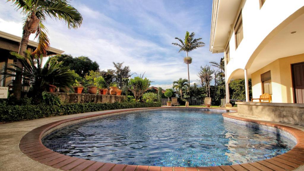 The swimming pool at or near La Riviera Hotel
