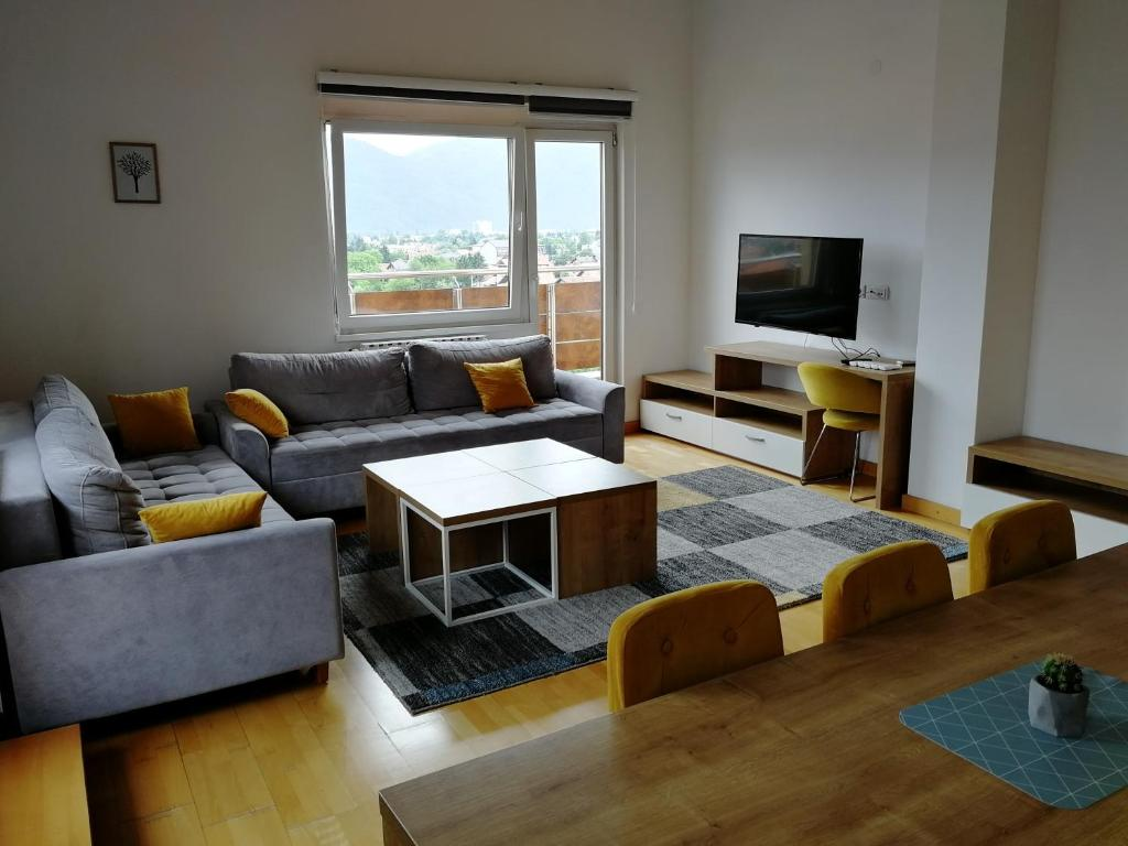 A seating area at VIP Apartments - Stup