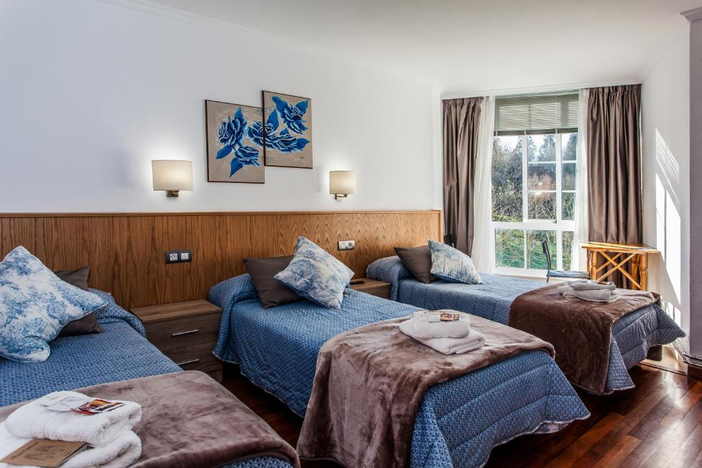 A bed or beds in a room at O Castelo