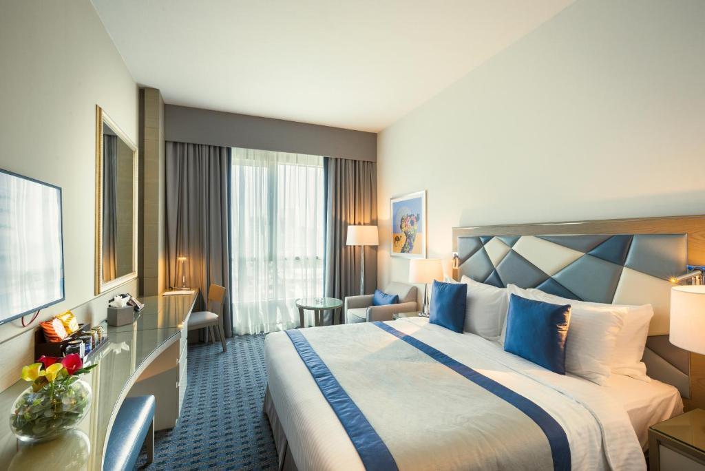 En eller flere senge i et værelse på Roda Links Al Nasr