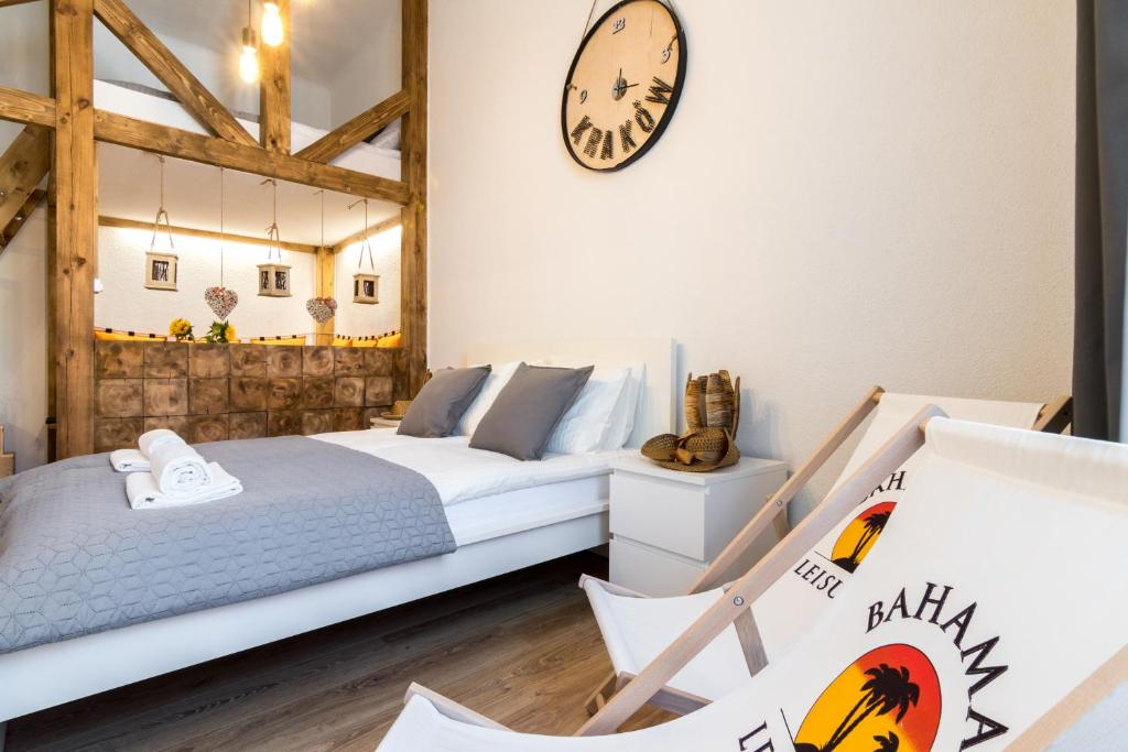 A bed or beds in a room at Cracow Best Location Apartment