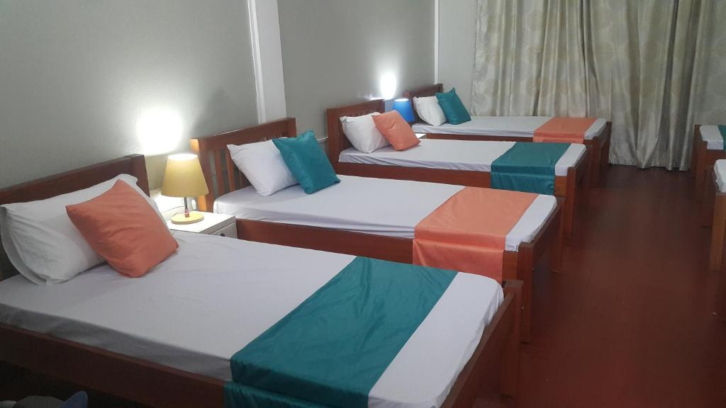 A bed or beds in a room at CDH Backpackers