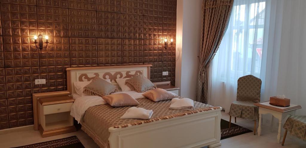 Un pat sau paturi într-o cameră la Vila Bohemia
