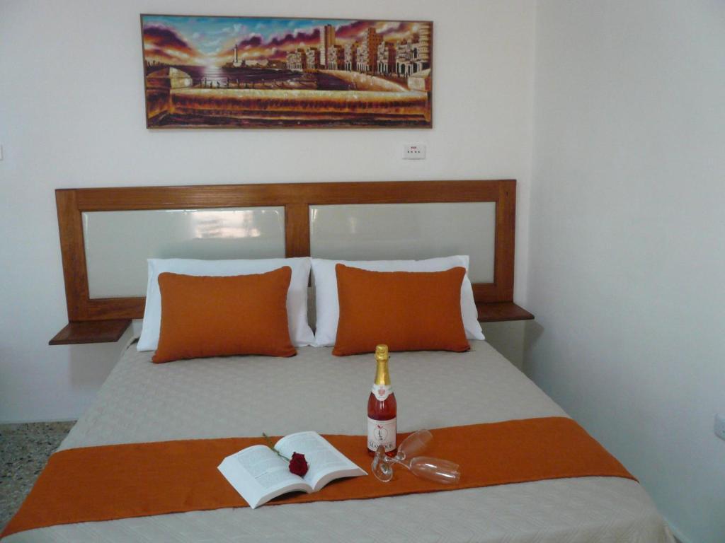 Postel nebo postele na pokoji v ubytování Hostal Málaga Habana