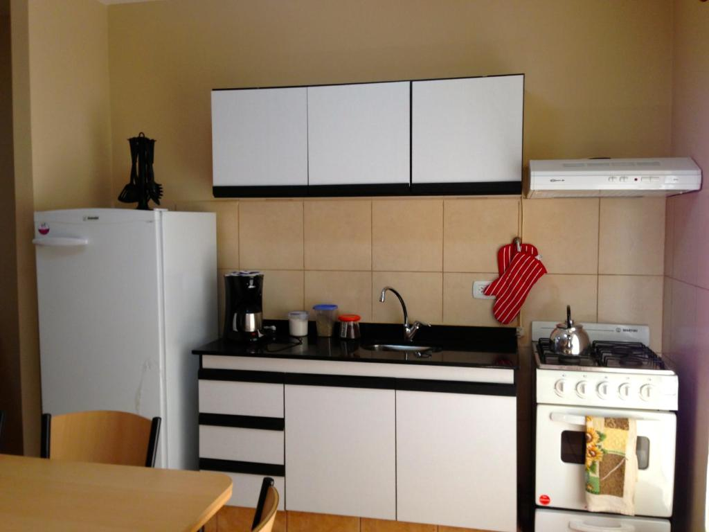 A kitchen or kitchenette at Naipi Apart