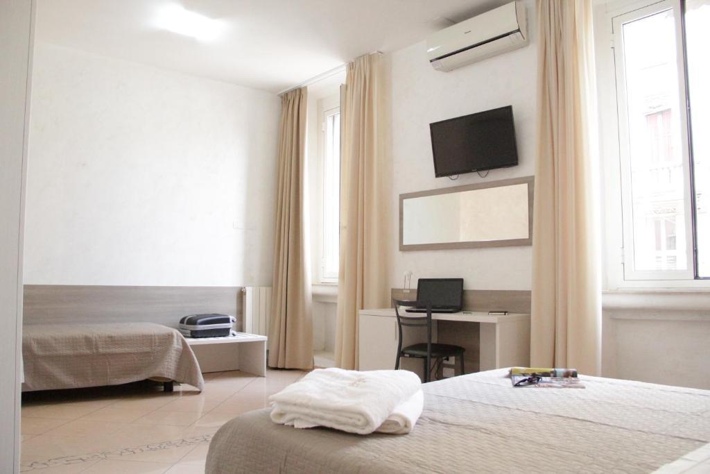 Llit o llits en una habitació de Hotel Siro