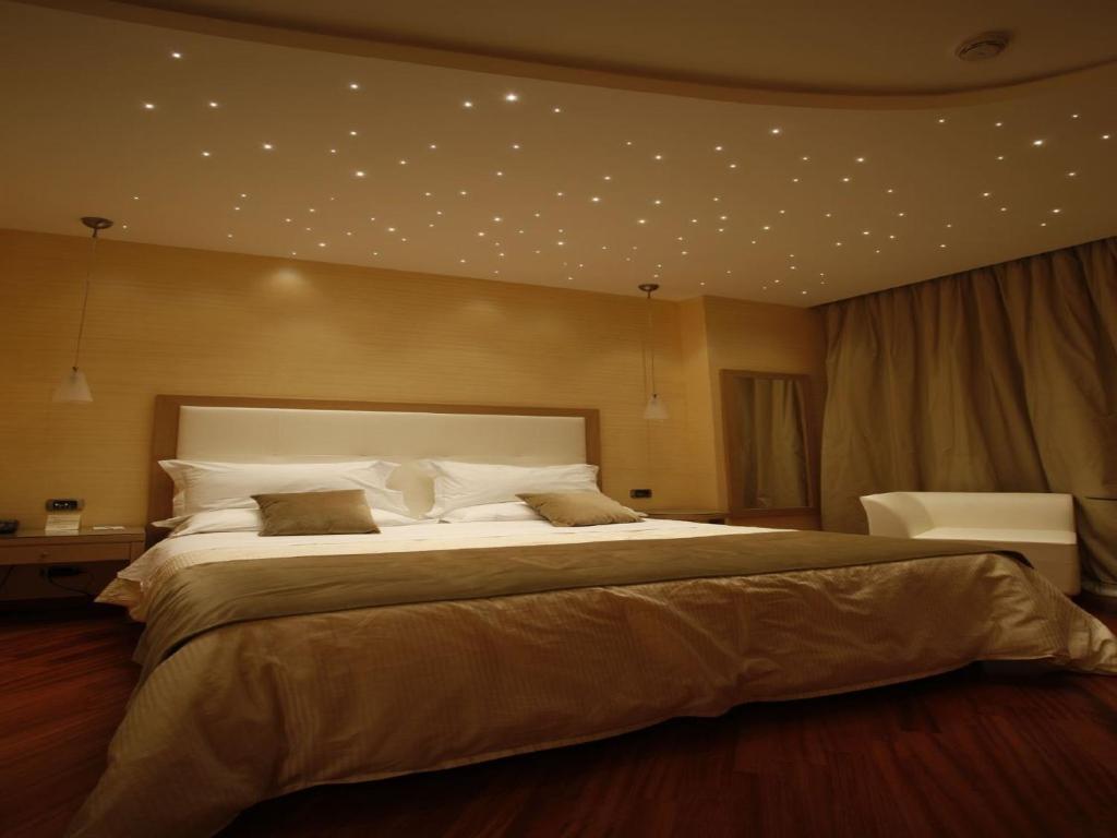 Een bed of bedden in een kamer bij Hotel Villa Esperia
