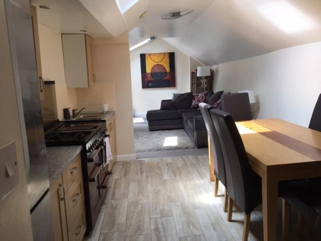 A kitchen or kitchenette at Otters' Holt