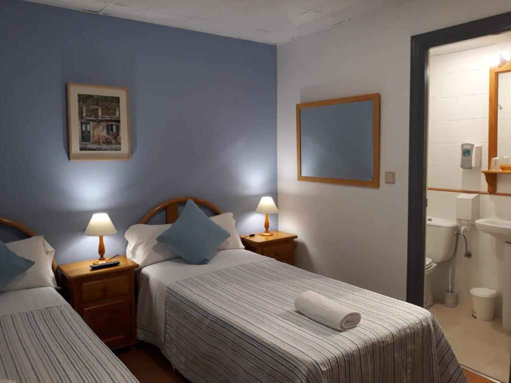 A bed or beds in a room at Pension Kaia