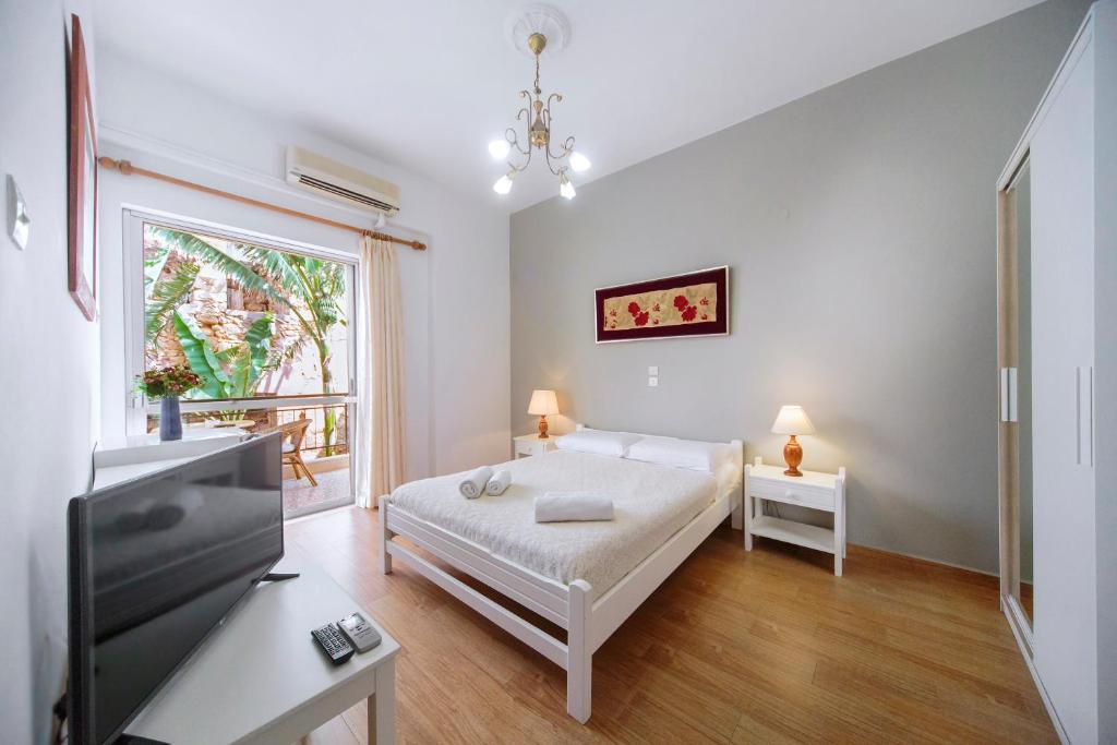A bed or beds in a room at Casa Kasteli
