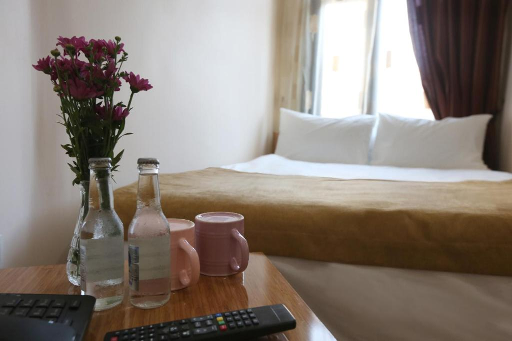 Кровать или кровати в номере Maxwell Hotel