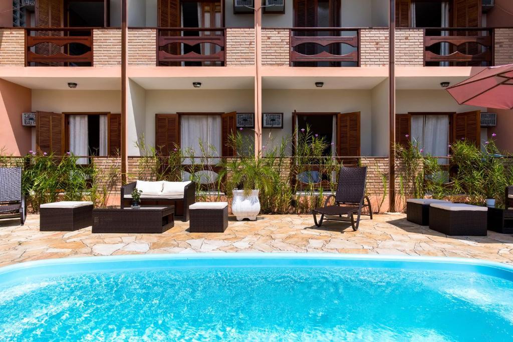 The swimming pool at or near Pousada Mar Azul