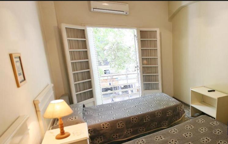 Una cama o camas en una habitación de Hotel Imperial