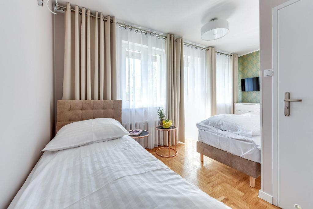 Łóżko lub łóżka w pokoju w obiekcie Meduza Sopot
