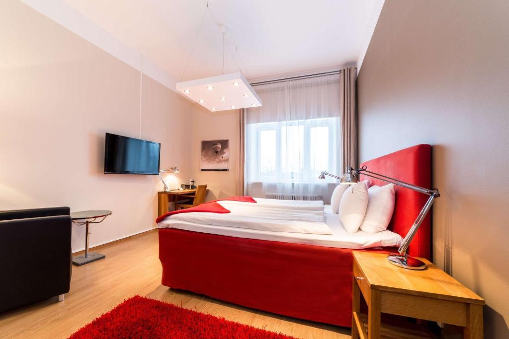 Best Western Hotel Duxiana tesisinde bir odada yatak veya yataklar