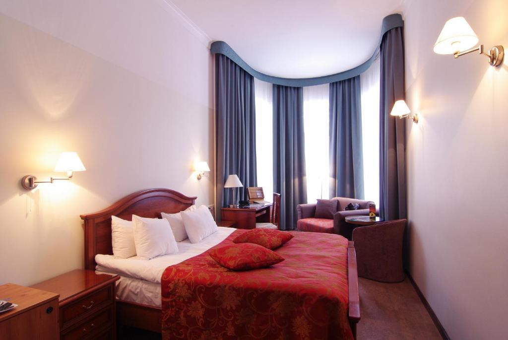 Vuode tai vuoteita majoituspaikassa Hotel St. Barbara