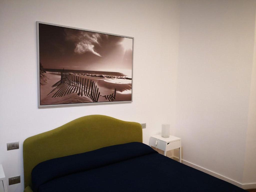 Ein Bett oder Betten in einem Zimmer der Unterkunft Central apartment