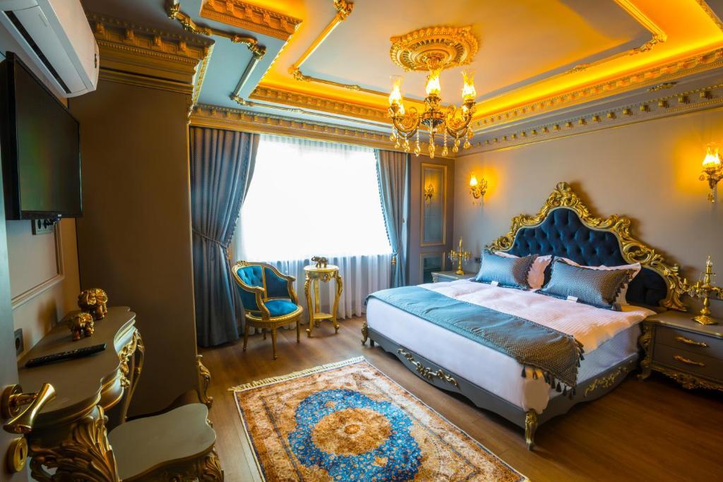Lova arba lovos apgyvendinimo įstaigoje Real King Suite Hotel