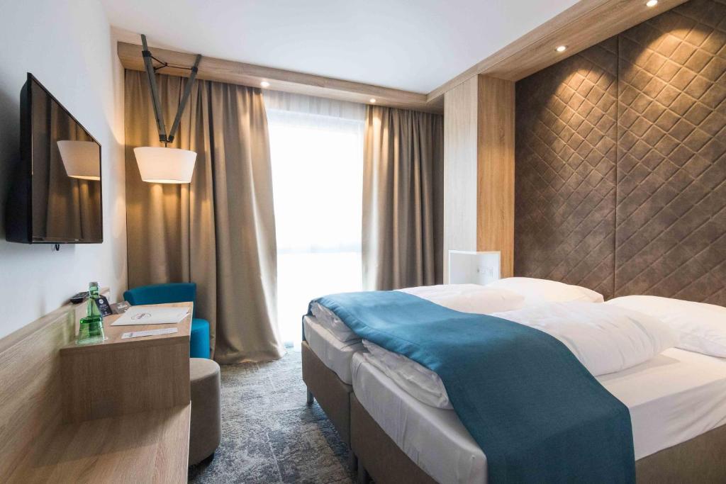 Ein Bett oder Betten in einem Zimmer der Unterkunft Das Alfred