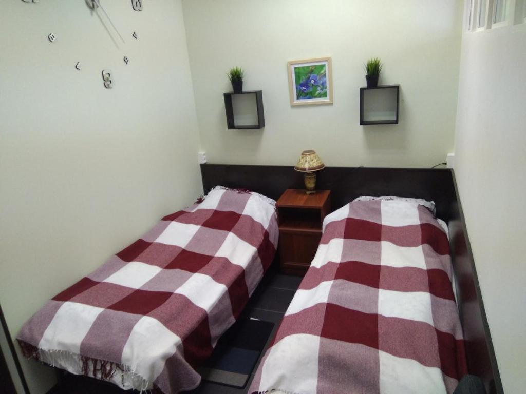 Кровать или кровати в номере Разлив - Залив Хостел & Отель