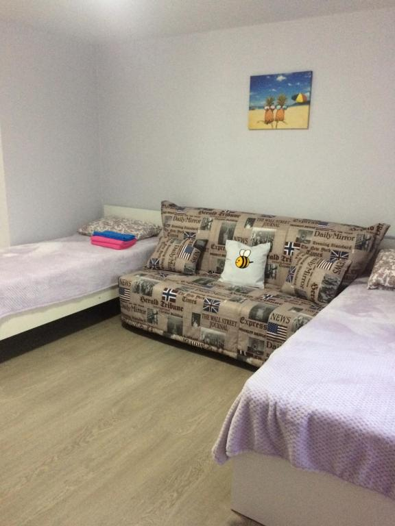 A bed or beds in a room at Guest House Bee