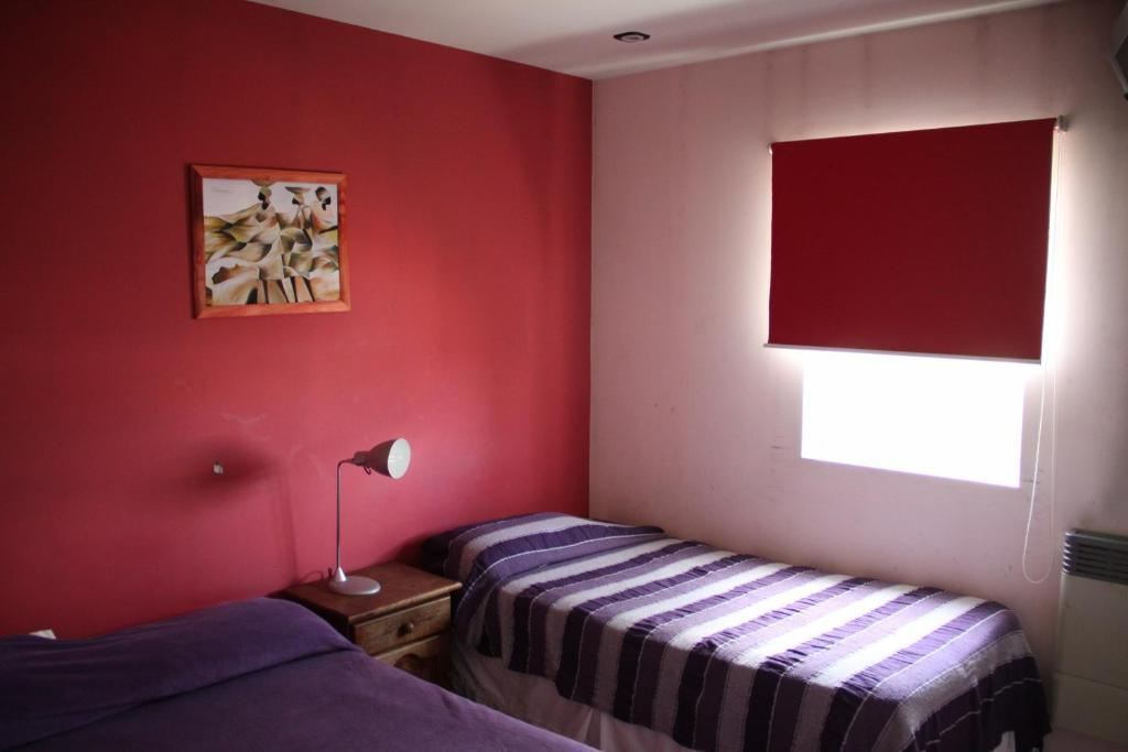 A bed or beds in a room at Hosteria La Posada