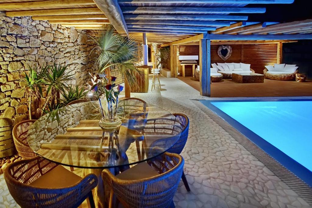 The swimming pool at or near Zinas Villas
