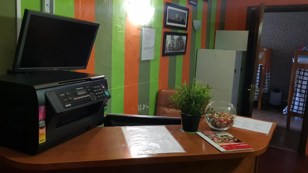 A television and/or entertainment center at Hostel Time at the Red Gate