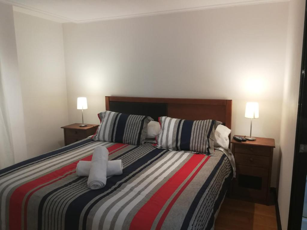 Cama o camas de una habitación en America Departamentos