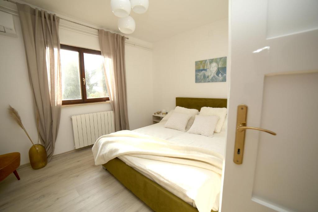 Posteľ alebo postele v izbe v ubytovaní Garden
