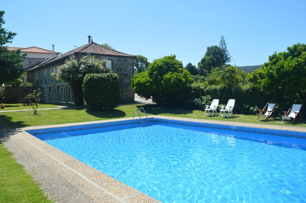 The swimming pool at or near Casa Do Carvalho