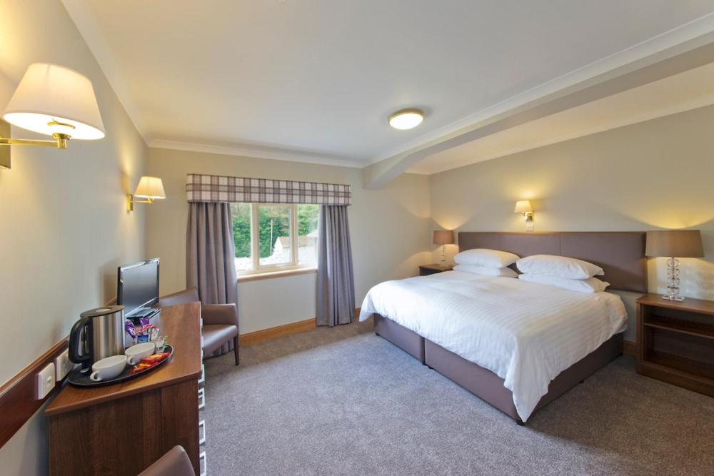 A bed or beds in a room at Tyndrum Lodges