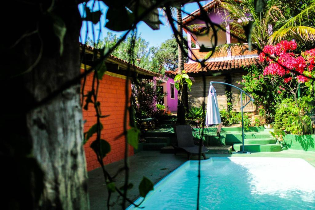 A piscina localizada em Pousada Refúgio ou nos arredores