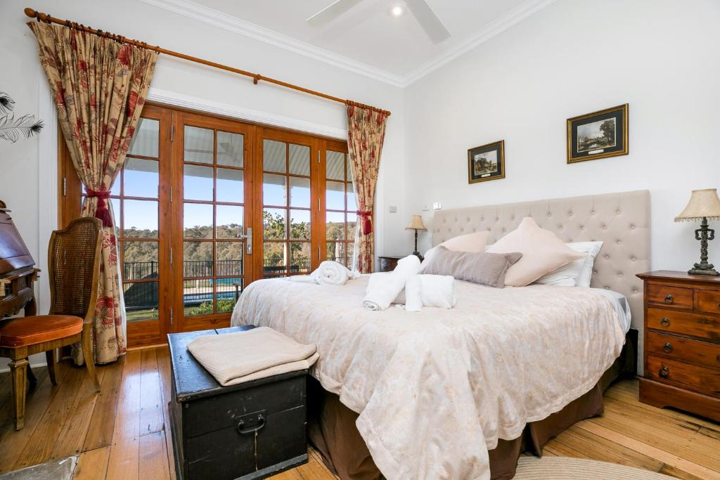 A bed or beds in a room at Taradale House Estate