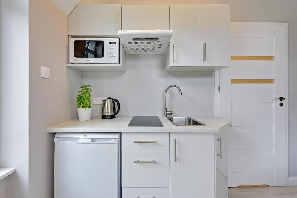 A kitchen or kitchenette at Hello Sopot