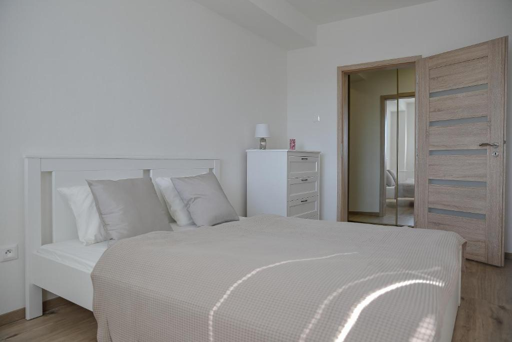 A bed or beds in a room at Eva apartments Pred polom