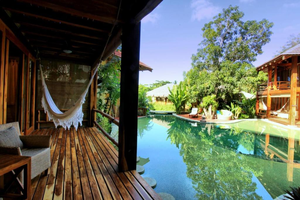 The swimming pool at or near Pranamar Villas & Yoga Retreat